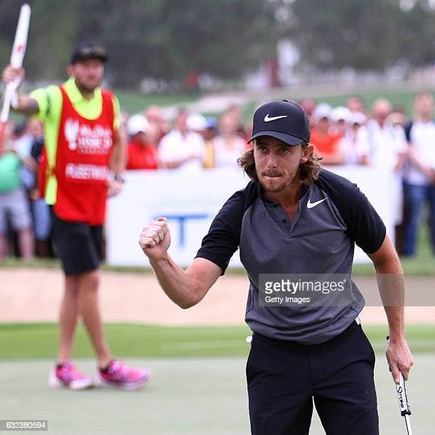 Tommy Fleetwood of England celebrates his birdie putt on the 18th green during the final round of the Abu Dhabi HSBC Championship at Abu Dhabi Golf...