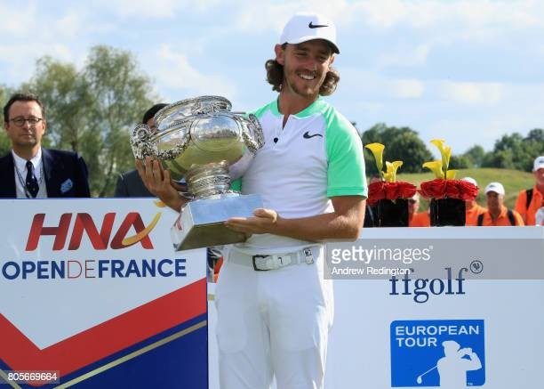 Tommy Fleetwood of England celebrates victory following day four of the HNA Open de France at Le Golf National on July 2 2017 in Paris France