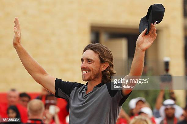 Tommy Fleetwood of England celebrates winning the tournament at the award ceremony during the final round of the Abu Dhabi HSBC Championship at Abu...