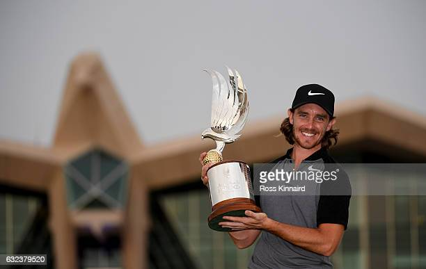 Tommy Fleetwood of England celebrates with the winners trophy after the final round of the Abu Dhabi HSBC Championship at Abu Dhabi Golf Club on...