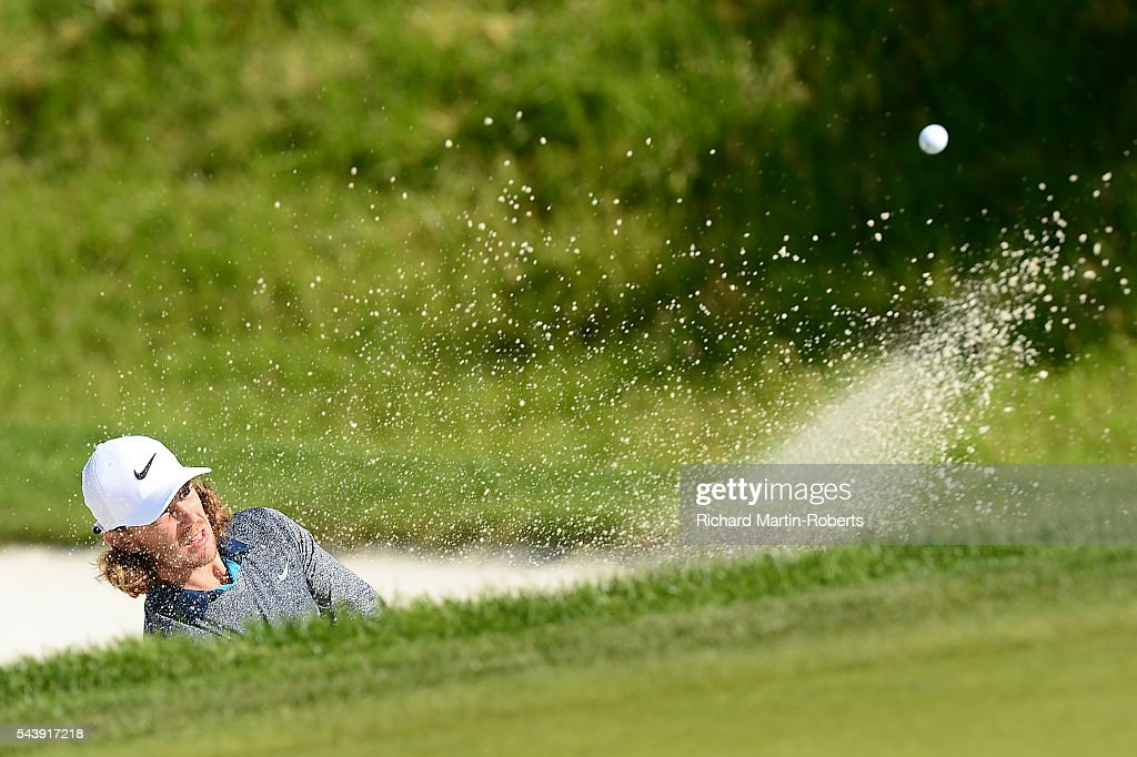 <a gi-track='captionPersonalityLinkClicked' href=/galleries/search?phrase=Tommy+Fleetwood&family=editorial&specificpeople=4450351 ng-click='$event.stopPropagation()'>Tommy Fleetwood</a> of England hits from a bunker on the 14th hole during the first round of the 100th Open de France at Le Golf National on June 30, 2016 in Paris, France.