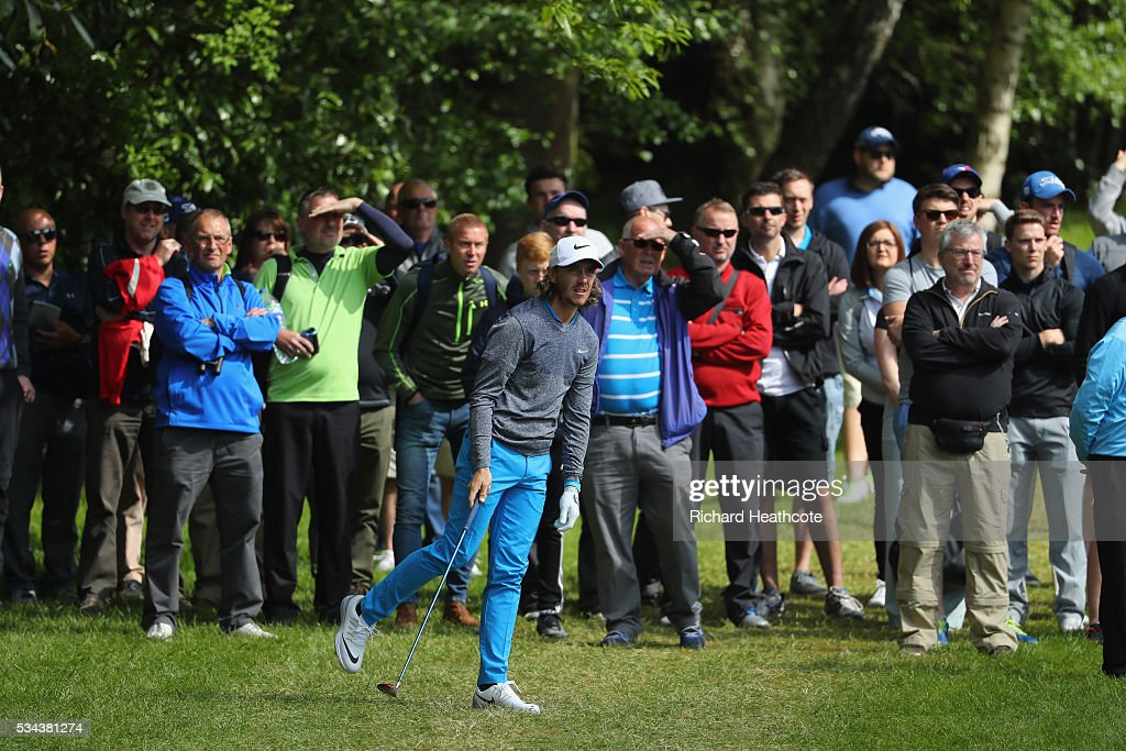 Tommy Fleetwood of England hits his 2nd shot on the 4th hole during day one of the BMW PGA Championship at Wentworth on May 26, 2016 in Virginia Water, England.