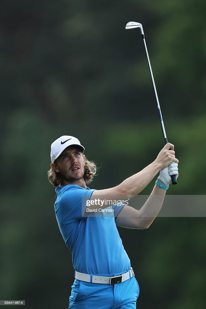 Tommy Fleetwood of England hits his 2nd shot on the 9th hole during day one of the BMW PGA Championship at Wentworth on May 26, 2016 in Virginia Water, England.