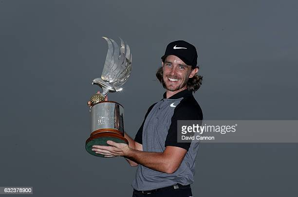 Tommy Fleetwood of England holds the trophy after his one shot win during the final round of the 2017 Abu Dhabi HSBC Championship at Abu Dhabi Golf...