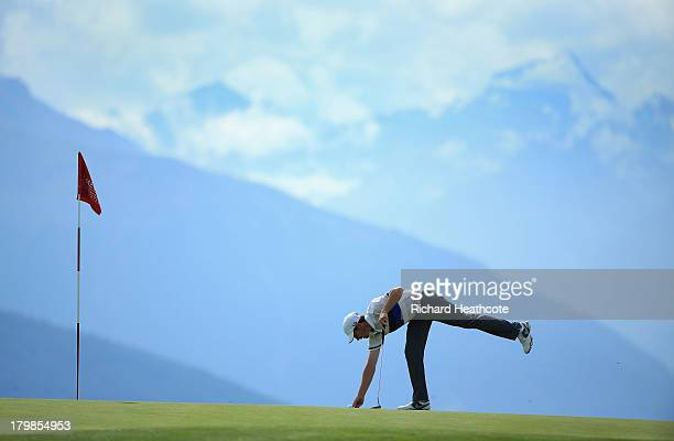 Tommy Fleetwood of England in action during the third round of the Omega European Masters at the CranssurSierre Golf Club on September 7 2013 in...