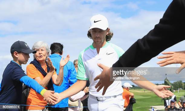 Tommy Fleetwood of England interacts with fans on the 15th hole during the final round of the HNA Open de France at Le Golf National on July 2 2017...