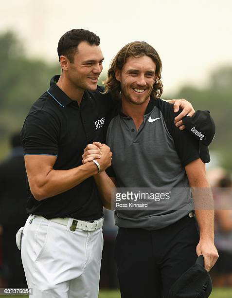 Tommy Fleetwood of England is congratulated by Martin Kaymer of Germany on the 18th green during the final round of the Abu Dhabi HSBC Championship...