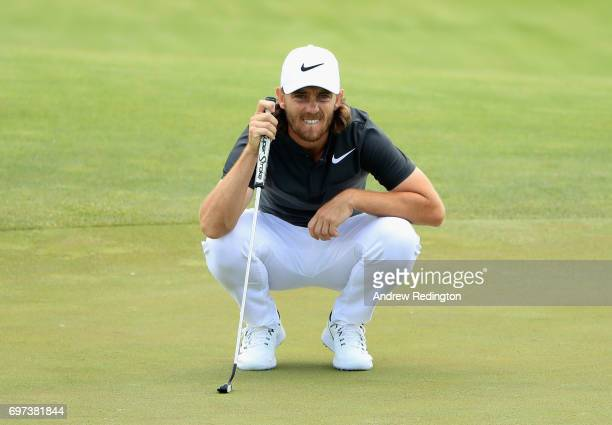 Tommy Fleetwood of England lines up a putt on the fifth green during the final round of the 2017 US Open at Erin Hills on June 18 2017 in Hartford...