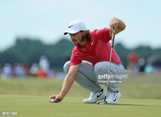 Tommy Fleetwood of England lines up a putt on the sixth green during the third round of the 2017 US Open at Erin Hills on June 17 2017 in Hartford...