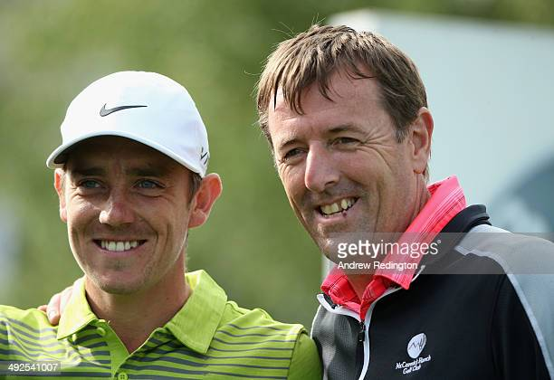 Tommy Fleetwood of England looks on with Matthew Le Tissier during the ProAm ahead of the BMW PGA Championship at Wentworth on May 21 2014 in...