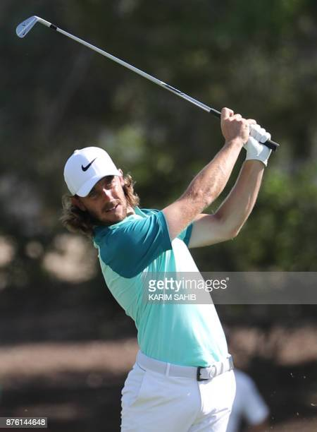 Tommy Fleetwood of England plays a shot during the final round of the DP World Tour Golf Championship at Jumeirah Golf Estates on November 19 in...