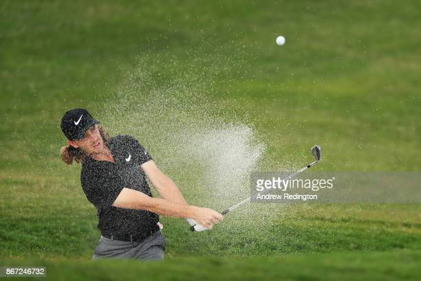 Tommy Fleetwood of England plays his fourth shot from a bunker on the second hole during the third round of the WGC HSBC Champions at Sheshan...