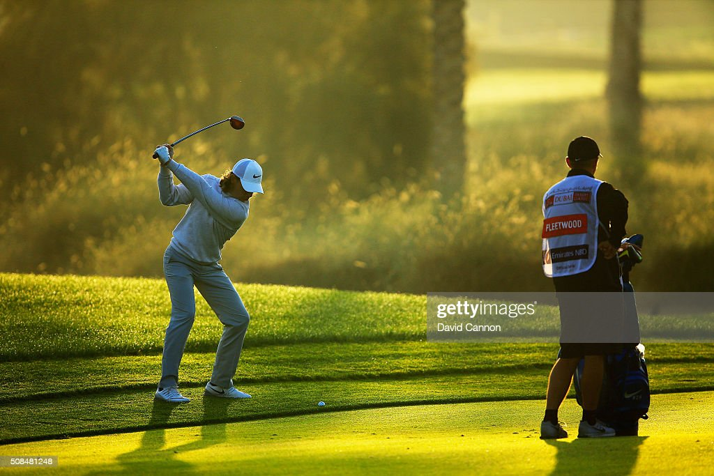Tommy Fleetwood of England plays his second shot at the par 5 10th hole during the second round of the 2016 Omega Dubai Desert Classic on the Majlis...