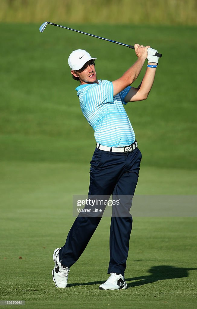 <a gi-track='captionPersonalityLinkClicked' href=/galleries/search?phrase=Tommy+Fleetwood&family=editorial&specificpeople=4450351 ng-click='$event.stopPropagation()'>Tommy Fleetwood</a> of England plays his second shot into the 18th green during the second round of the Tshwane Open at Copperleaf Golf & Country Estate on February 28, 2014 in Centurion, South Africa.