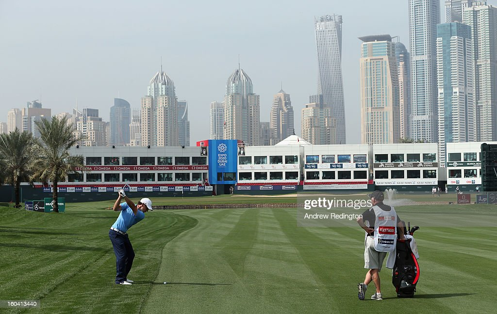 Tommy Fleetwood of England plays his second shot on the 18th hole during the first round of the Omega Dubai Desert Classic at Emirates Golf Club on January 31, 2013 in Dubai, United Arab Emirates.
