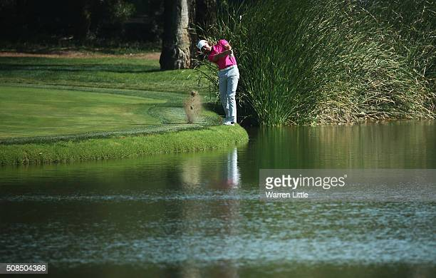Tommy Fleetwood of England plays his second shot on the 9th hole during the second round of the Omega Dubai Desert Classic at the Emirates Golf Club...