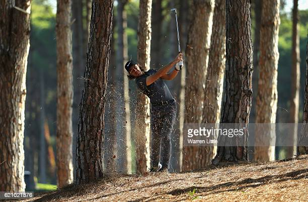 Tommy Fleetwood of England plays his second shot out of the trees on the 12th hole during the second round of the Turkish Airlines Open at the Regnum...