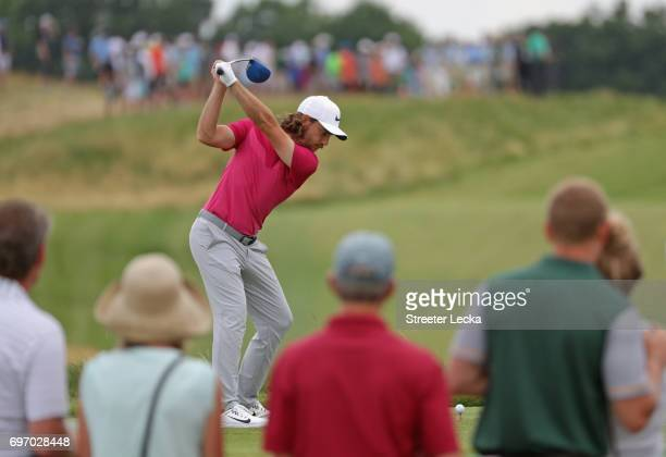 Tommy Fleetwood of England plays his shot from the 12th tee during the third round of the 2017 US Open at Erin Hills on June 17 2017 in Hartford...