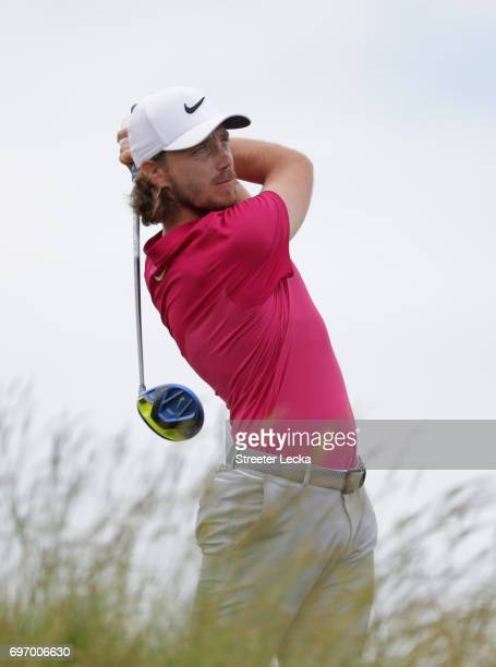 Tommy Fleetwood of England plays his shot from the fifth tee during the third round of the 2017 US Open at Erin Hills on June 17 2017 in Hartford...