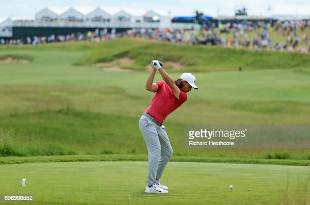 Tommy Fleetwood of England plays his shot from the first tee during the third round of the 2017 US Open at Erin Hills on June 17 2017 in Hartford...
