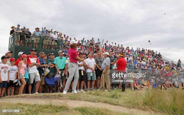 Tommy Fleetwood of England plays his shot on the 15th hole during the third round of the 2017 US Open at Erin Hills on June 17 2017 in Hartford...