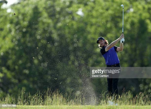 Tommy Fleetwood of England plays his tee shot on the par 3 16th hole during the second round of the 117th US Open Championship at Erin Hills on June...
