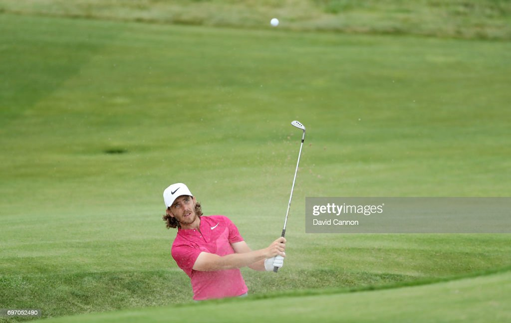 Tommy Fleetwood of England plays his third shot at the par 5, 14th hole during the third round of the 117th US Open Championship at Erin Hills on June 17, 2017 in Hartford, Wisconsin.