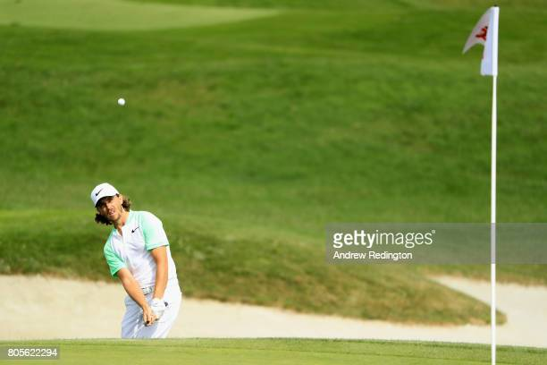 Tommy Fleetwood of England plays his third shot out of the bunker on the 14th during day four of the HNA Open de France at Le Golf National on July 2...