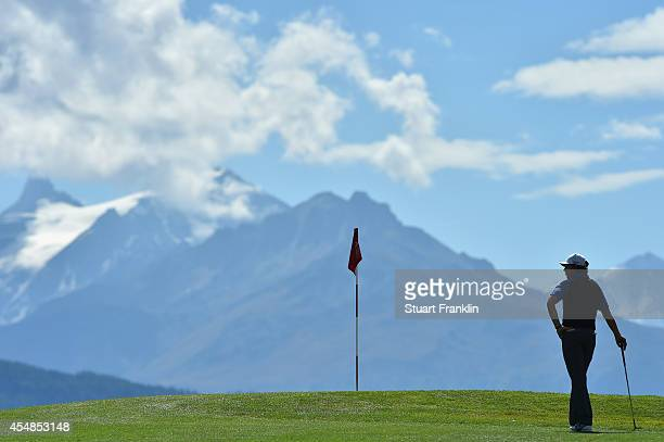 Tommy Fleetwood of England ponders a shot during the final round of the Omega European Masters at CranssurSierre Golf Club on September 7 2014 in...