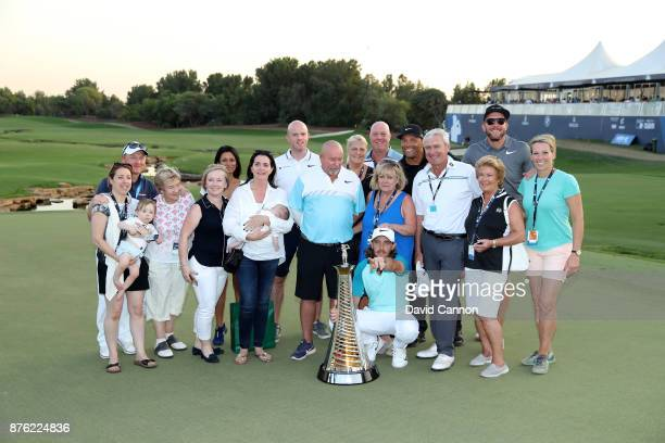 Tommy Fleetwood of England poses with the Race to Dubai trophy and his 'Team Fleetwood' after the final round of the 2017 DP World Tour Championship...