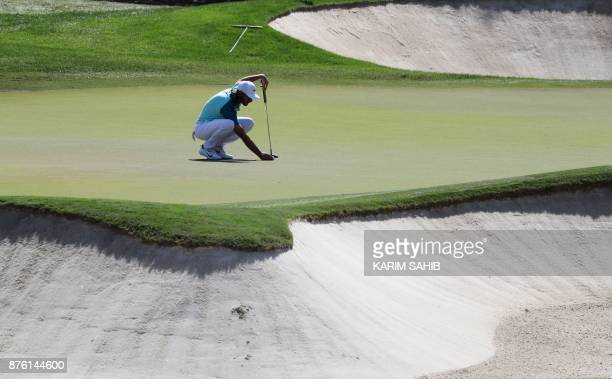 Tommy Fleetwood of England prepares to play a shot during the final round of the DP World Tour Golf Championship at Jumeirah Golf Estates on November...