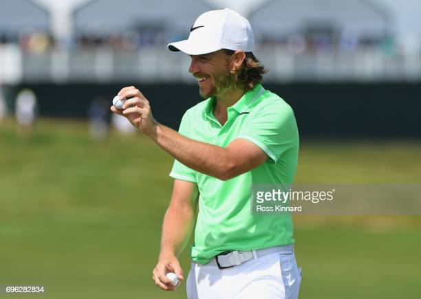 Tommy Fleetwood of England reacts after making a birdie on the 18th green during the first round of the 2017 US Open at Erin Hills on June 15 2017 in...