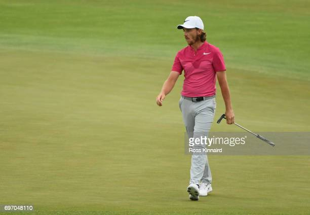 Tommy Fleetwood of England walks across the 18th green during the third round of the 2017 US Open at Erin Hills on June 17 2017 in Hartford Wisconsin