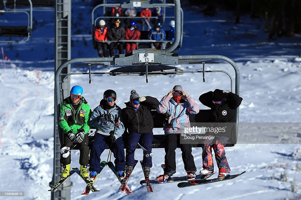 Tommy Ford (L) of the US Ski Team rides the lift with guests on a tour of the US Ski Team Speed Center at Copper on October 31, 2012 in Copper Mountain, Colorado. The athletes will begin training at the facility on November 1, 2012.