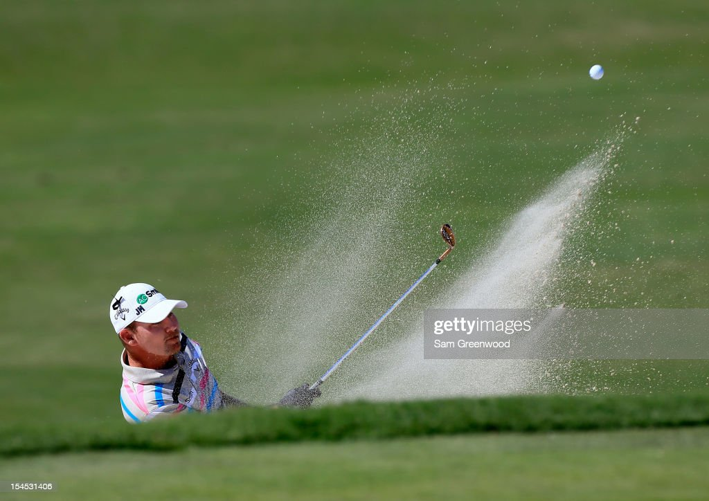 Tommy Gainey hits a shot from the bunker on the 15th hole during the final round of The McGladrey Classic at Sea Island's Seaside Course on October...