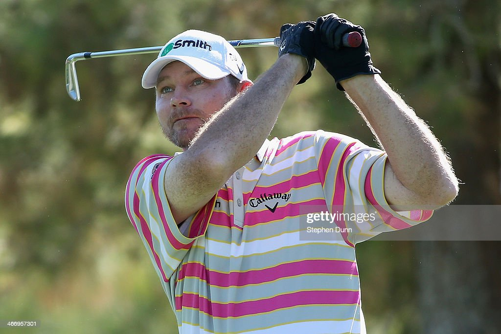 Tommy Gainey hits a tee shot on the 12th hole at La Quinta Country Club Course during the second round of the Humana Challenge in partnership with...
