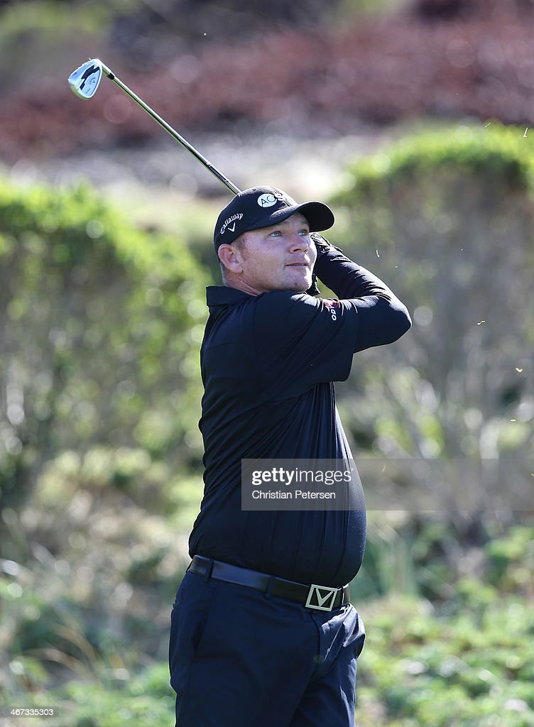 Tommy Gainey hits a tee shot on the third hole during the first round of the ATT Pebble Beach National ProAm at Spyglass Hill Golf Course on February...