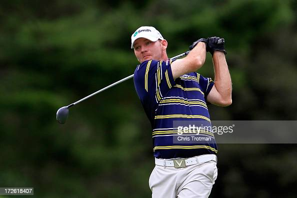 Tommy Gainey hits his second shot on the 12th hole during round one of the Greenbrier Classic at the Old White TPC on July 4 2013 in White Sulphur...