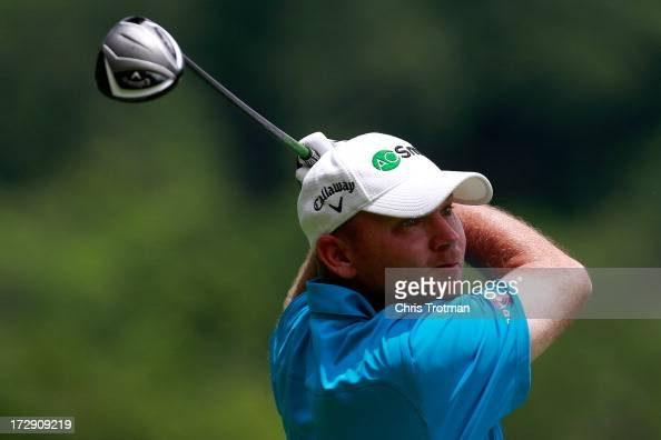 Tommy Gainey hits his tee shot on the 13th hole during round two of the Greenbrier Classic at the Old White TPC on July 5 2013 in White Sulphur...