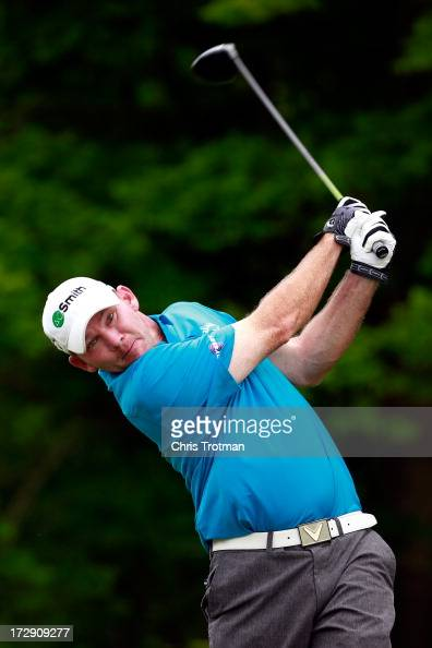 Tommy Gainey hits his tee shot on the 17th hole during round two of the Greenbrier Classic at the Old White TPC on July 5 2013 in White Sulphur...