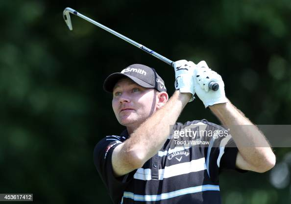 Tommy Gainey plays his tee shot on the seventh hole during the first round of the Wyndham Championship at Sedgefield Country Club on August 14 2014...