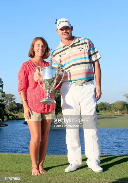 Tommy Gainey poses with his wife Erin following the final round of The McGladrey Classic at Sea Island's Seaside Course on October 21 2012 in Sea...
