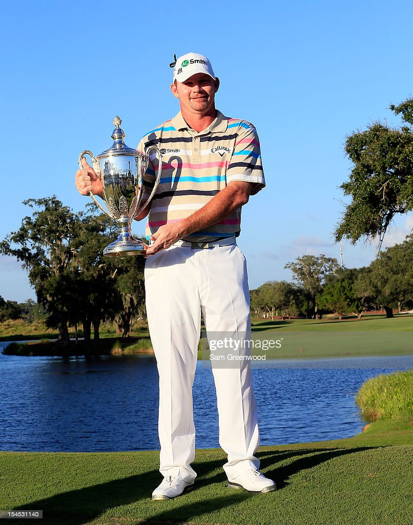 Tommy Gainey poses with the trophy after winning The McGladrey Classic at Sea Island's Seaside Course on October 21 2012 in Sea Island Georgia