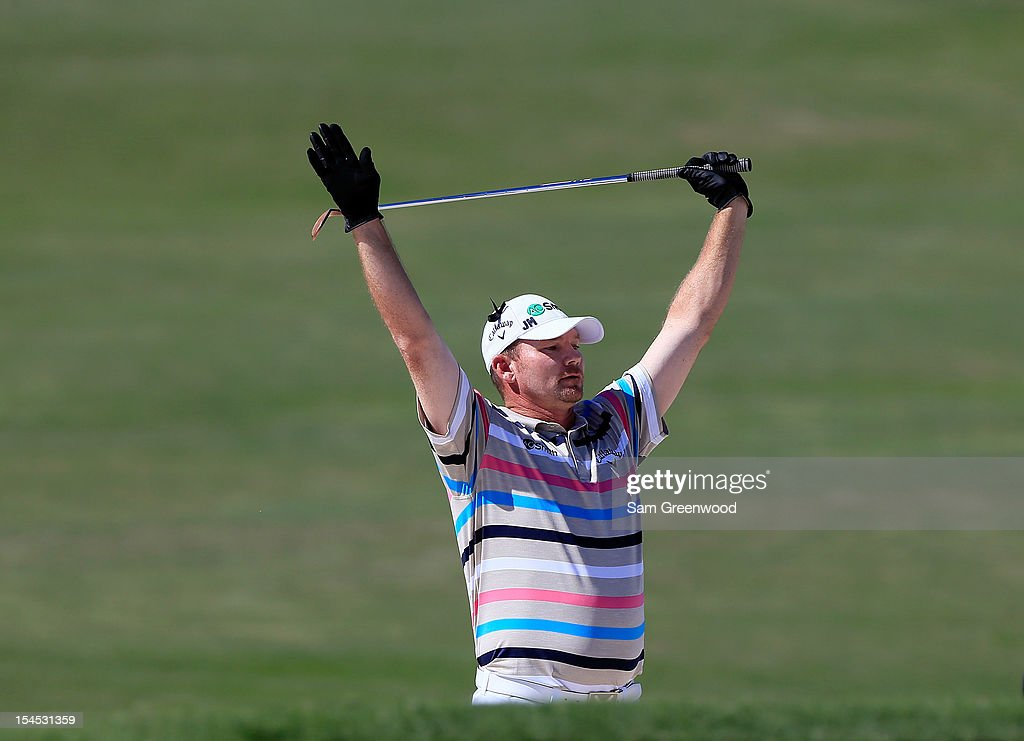 Tommy Gainey reacts to an eagle from the bunker on the 15th hole during the final round of The McGladrey Classic at Sea Island's Seaside Course on...