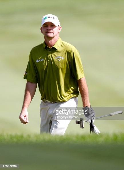Tommy Gainey walks up to the second green during the First Round of the World Golf ChampionshipsBridgestone Invitational at Firestone Country Club...