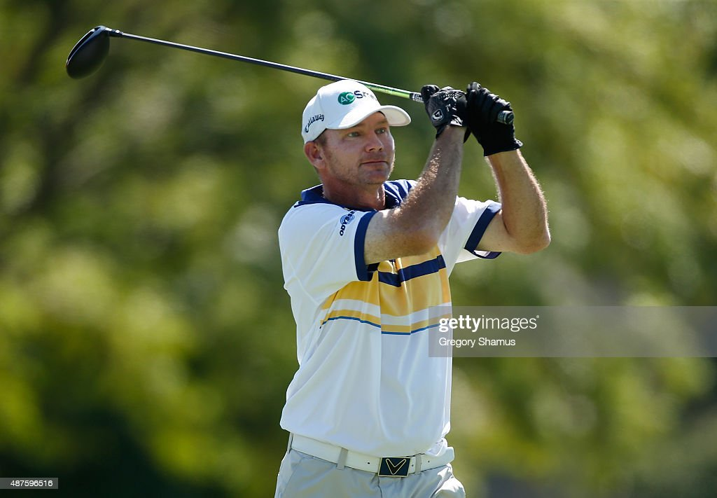 Tommy Gainey watches his tee shot on the ninth hole during the first round round of the Webcom Tour Hotel Fitness Championship at Sycamore Hills Golf...