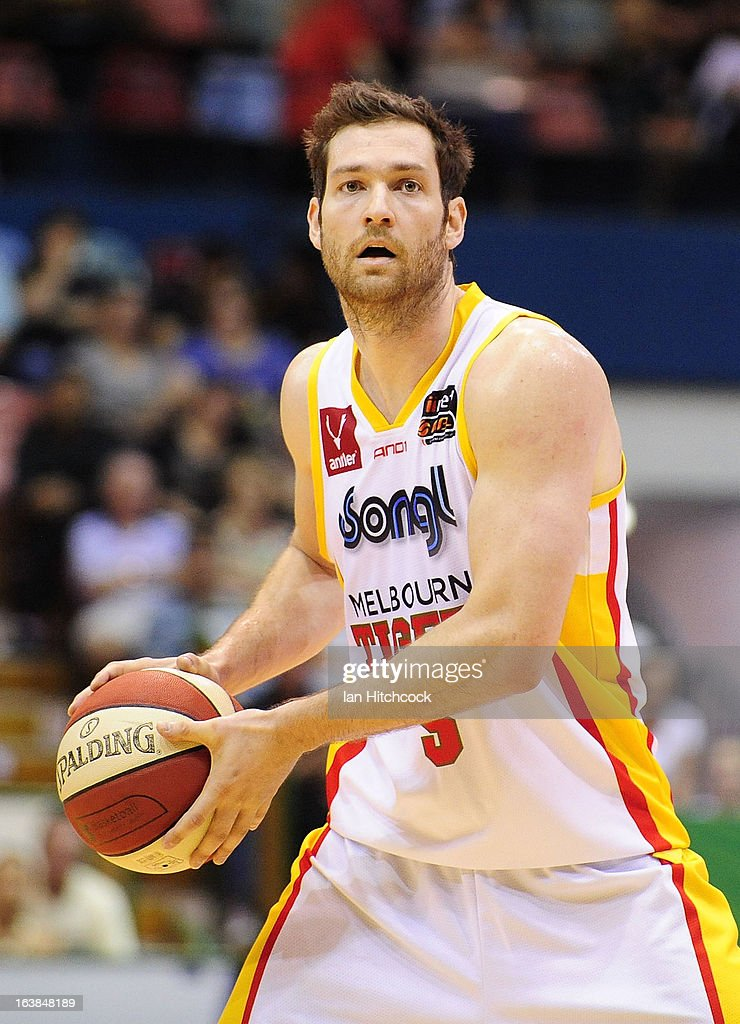 Tommy Greer of the Tigers looks to pass the ball during the round 23 NBL match between the Townsville Crocodiles and the Melbourne Tigers at Townsville Entertainment Centre on March 17, 2013 in Townsville, Australia.