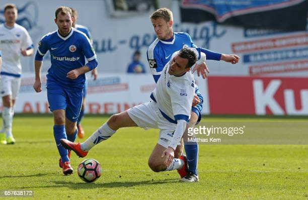 Tommy Grupe of Rostock battles for the ball with Koen van der Biezen of Paderborn during the third league match between FC Hansa Rostock and SC...
