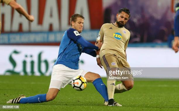 Tommy Grupe of Rostock battles for the ball with Marcos Alvarez of Osnabrueck during the third league match between FC Hansa Rostock and VfL...