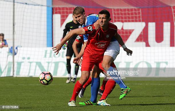 Tommy Grupe of Rostock battles for the ball with Ronny Koenig of Zwickau during the third league match between FC Hansa Rostock and FSV Zwickau at...